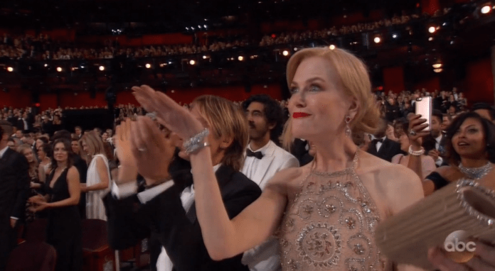 "Nicole Kidman's reaction to ""Moonlight"" winning was priceless. Behind her, Taraji P. Henson snapped away at the entire scene."