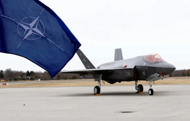 NATO flag flutters next to the U.S. Air Force F-35A Lightning II fighter in Amari air base, Estonia, April 25, 2017. REUTERS/Ints Kalnins