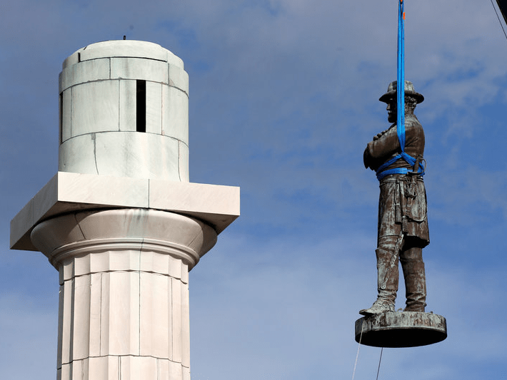 FILE PHOTO - A monument of Robert E. Lee, who was a general in the Confederate Army, is removed in New Orleans, Louisiana, U.S. on May 19, 2017. REUTERS/Jonathan Bachman/File Photo