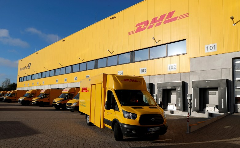 FILE PHOTO: An electric powered truck of German postal and logistics group Deutsche Post DHL is pictured at a parcels distribution centre in Berlin, Germany, September 18, 2019. REUTERS/Fabrizio Bensch/File Photo