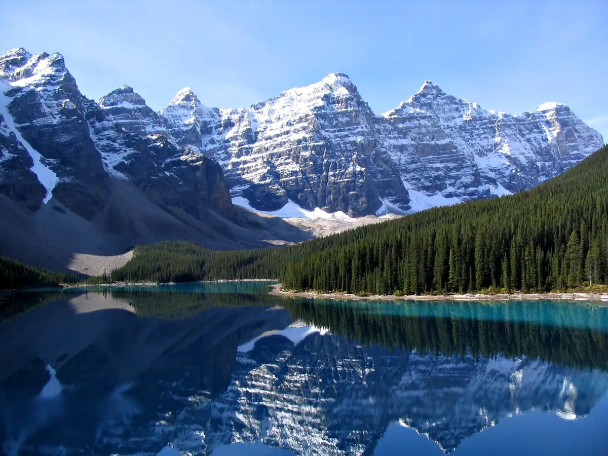 See the reflection of the spectacular Rocky Mountains in Moraine Lake at Banff National Park, Canada.