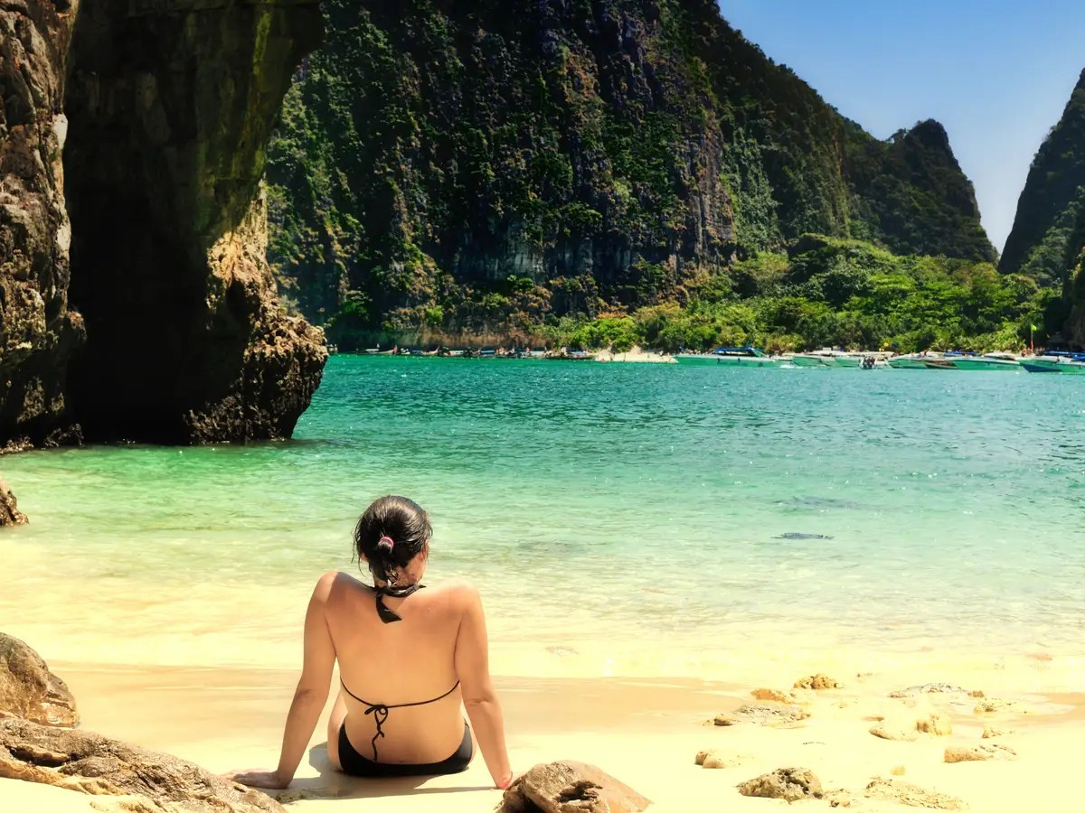 "Limestone cliffs shelter the beaches on Koh Phi Phi Leh, in southern Thailand. Maya Beach was made famous by the movie ""The Beach"" and gets overcrowded during the day, so check out the beautiful Ao Ton Sai or Laem Tong for more a more peaceful atmosphere."