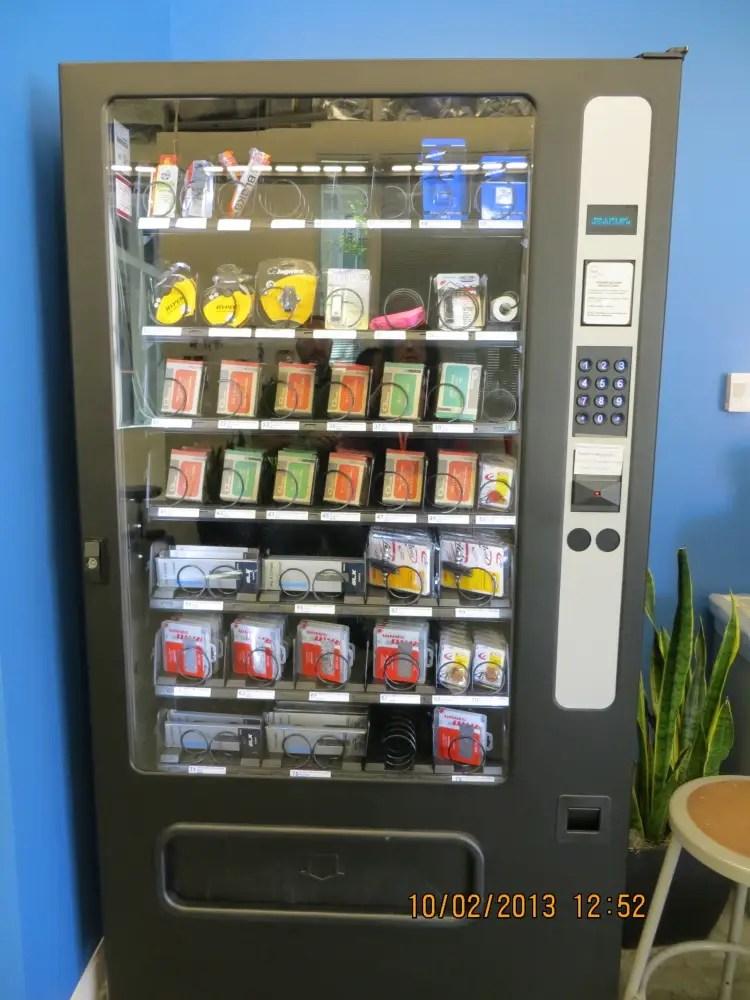 The bike shop's vending machine has bike parts like tire tubes, brake pads, chain links.