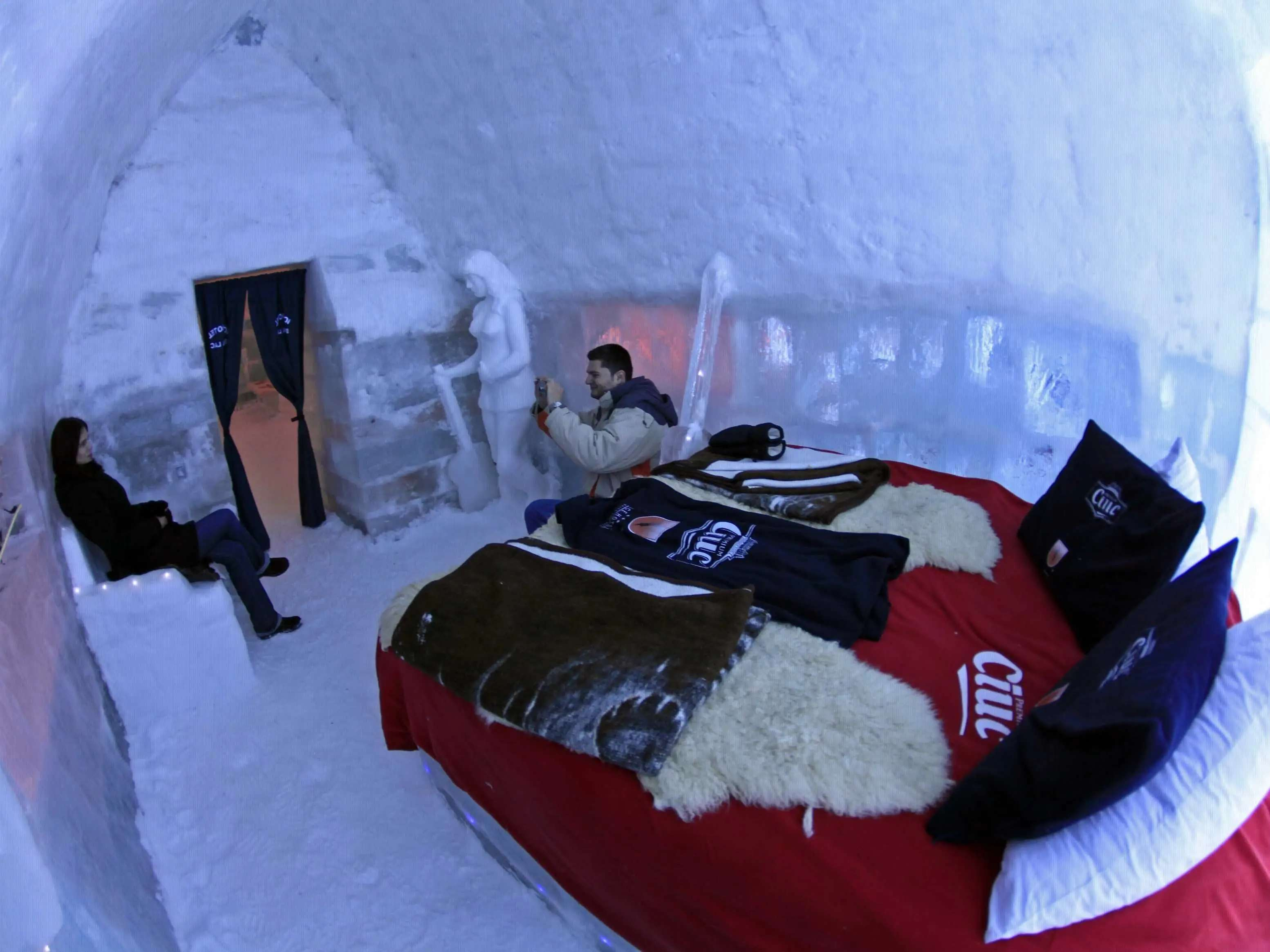Spend a night cozied up in an ice hotel, like the Ice Hotel Romania in the Fagaras Mountains near Bucharest.