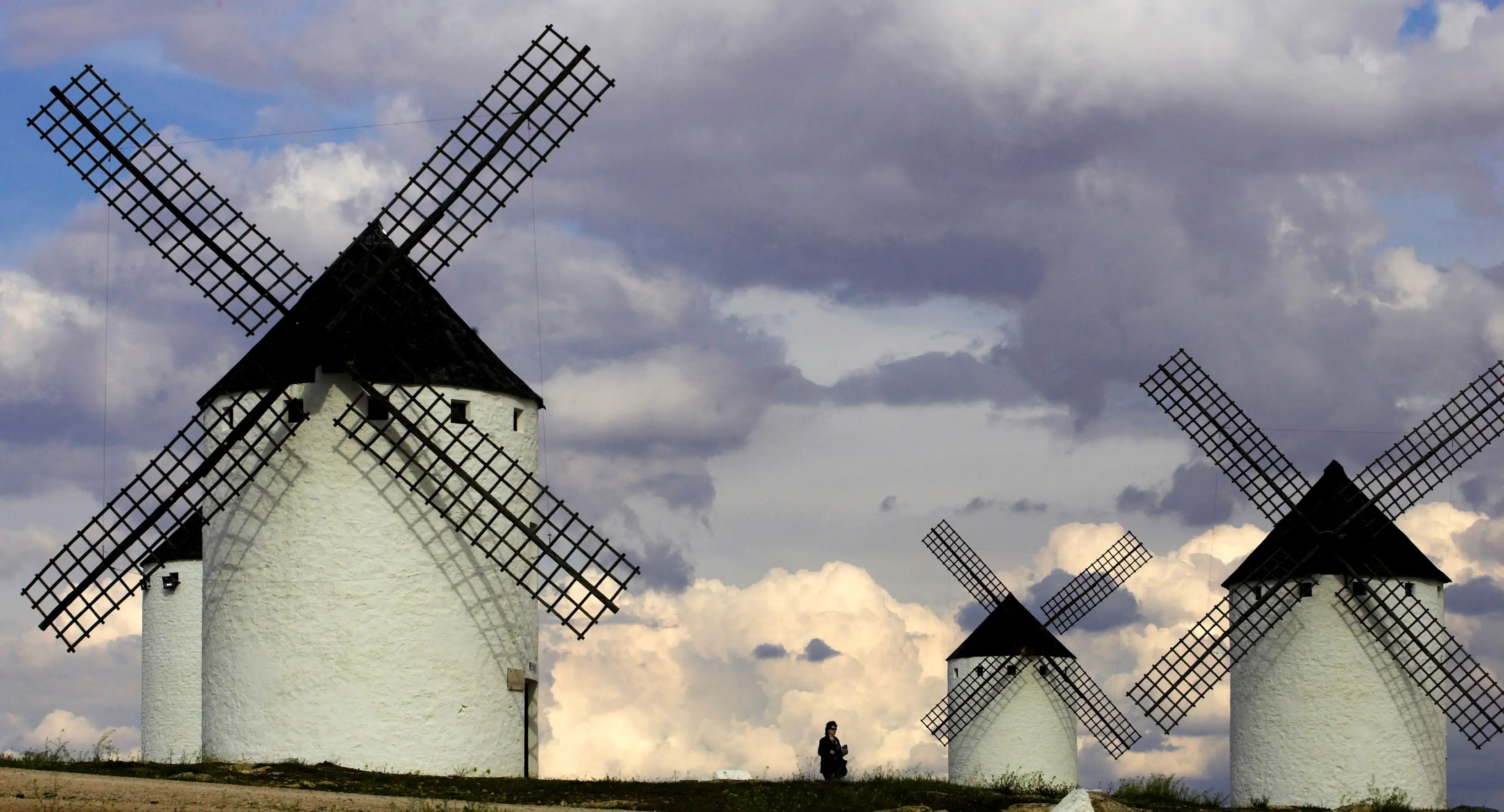 Tourists visit the famous ancient windmills in central Spain.