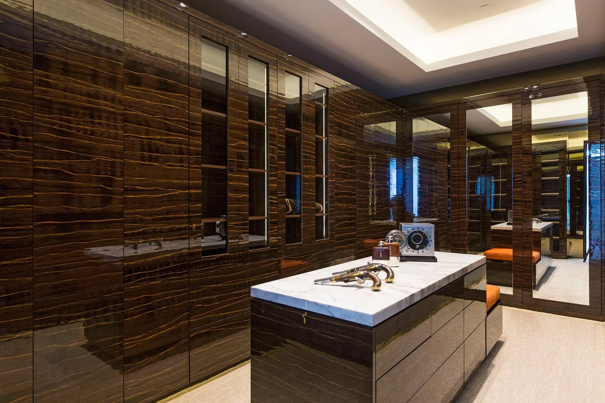 The master bedroom's closets are bigger than most New York apartments, designed to be both his ...
