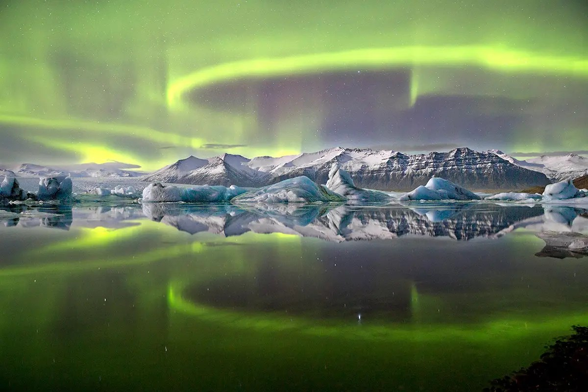 Aurora over a glacier lagoon © James Woodend HIGH RES