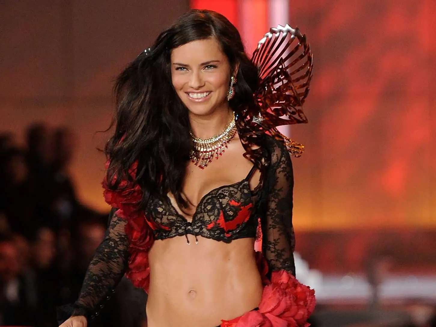 Adriana Lima walking down the runway