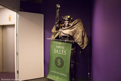 "Around the corner, a character from the role-playing open-world game Fallout greets you with its laser rifle. The Sales team dressed it up in ""Game of Thrones"" garb for an office contest."