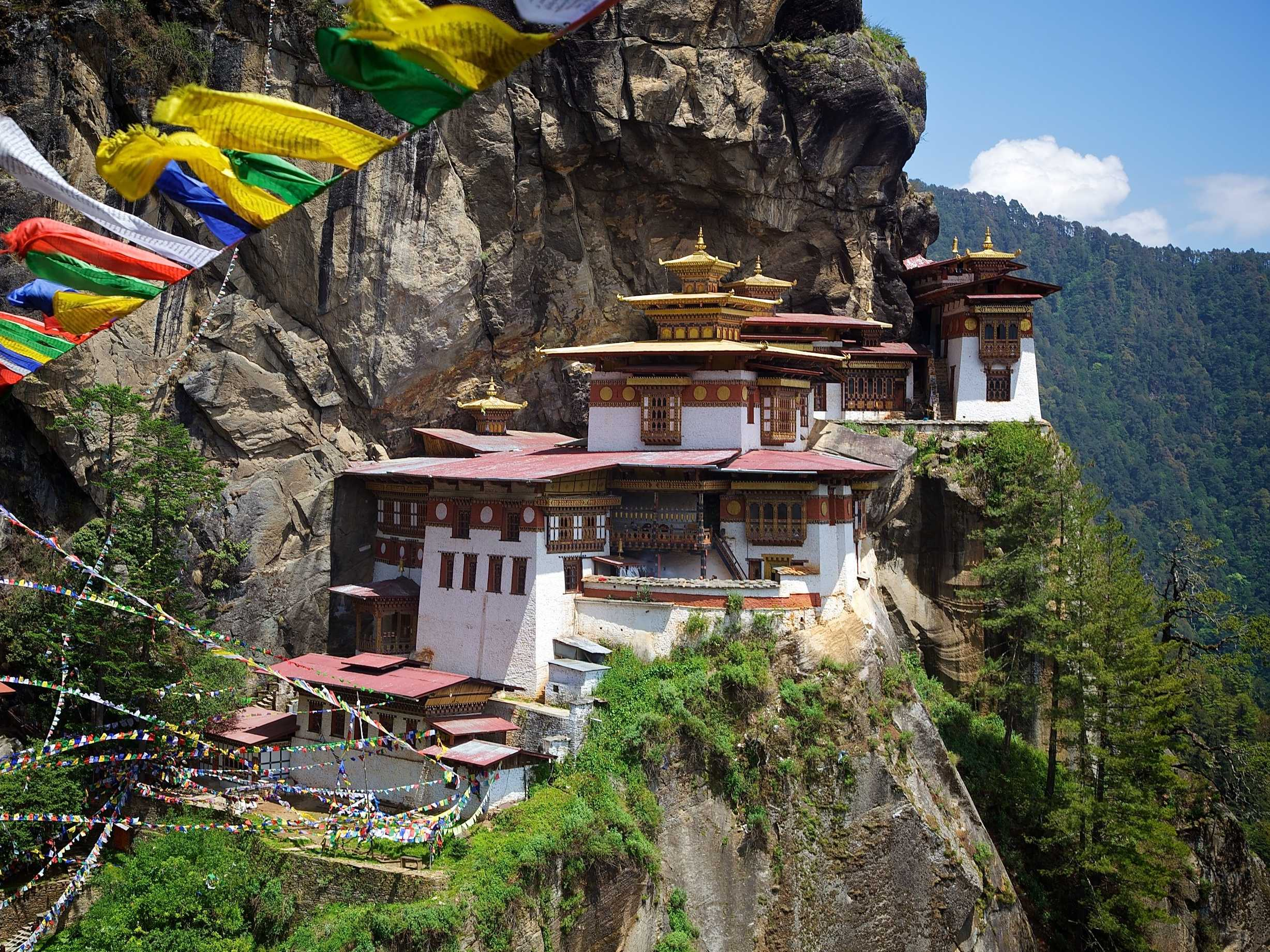 "Climb up to the Taktsang Palphug Monastery, known as the Tiger's Nest, in Paro valley, Bhutan. Padmasambhava, or the ""Second Buddha"" of Bhutan, is believed to have meditated here."