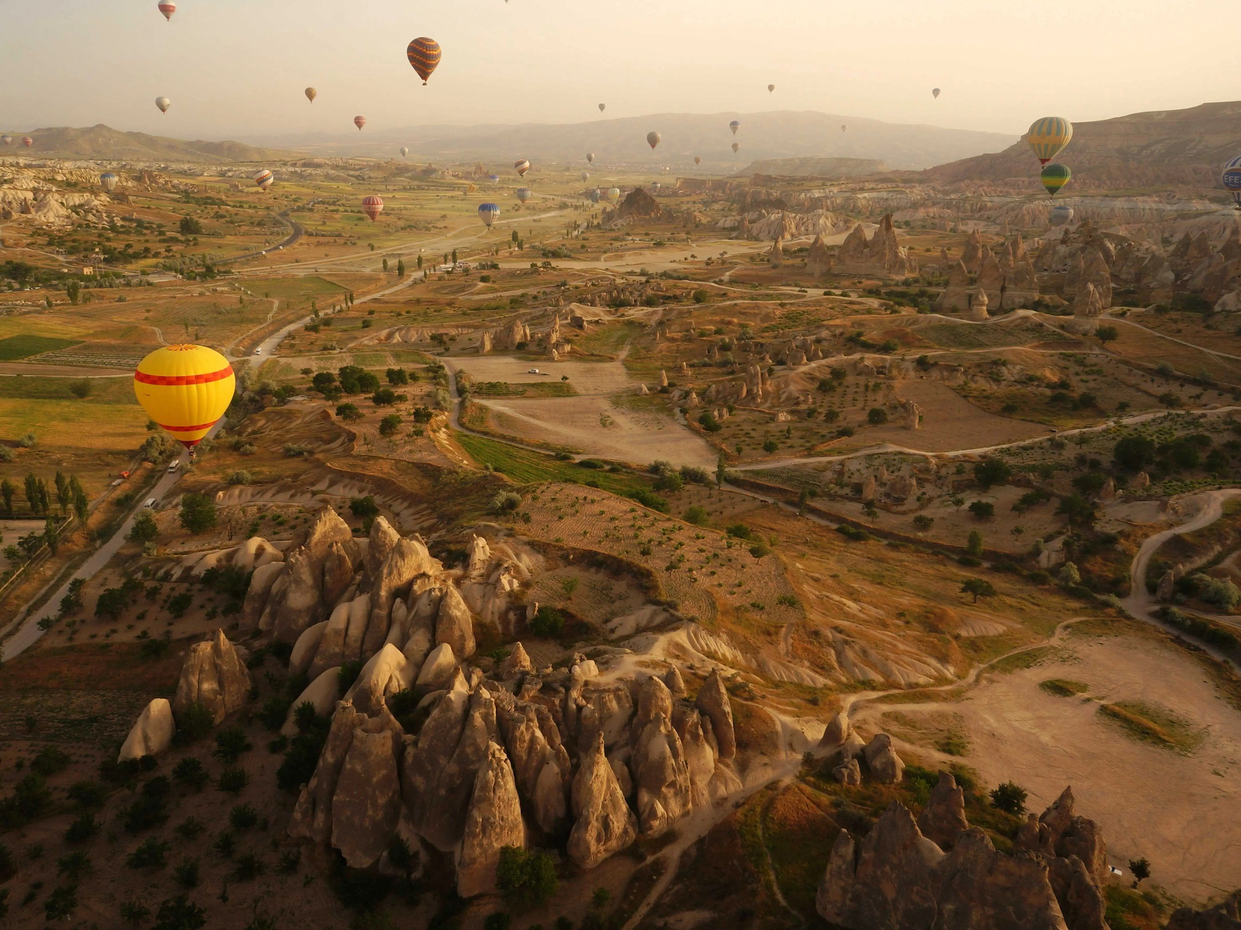"Göreme National Park and the Rock Sites of Cappadocia is a volcanic landscape created entirely from erosion that eventually formed mountain ridges, valleys, and pinnacles nicknamed ""fairy chimneys"" across Cappadocia, Turkey."