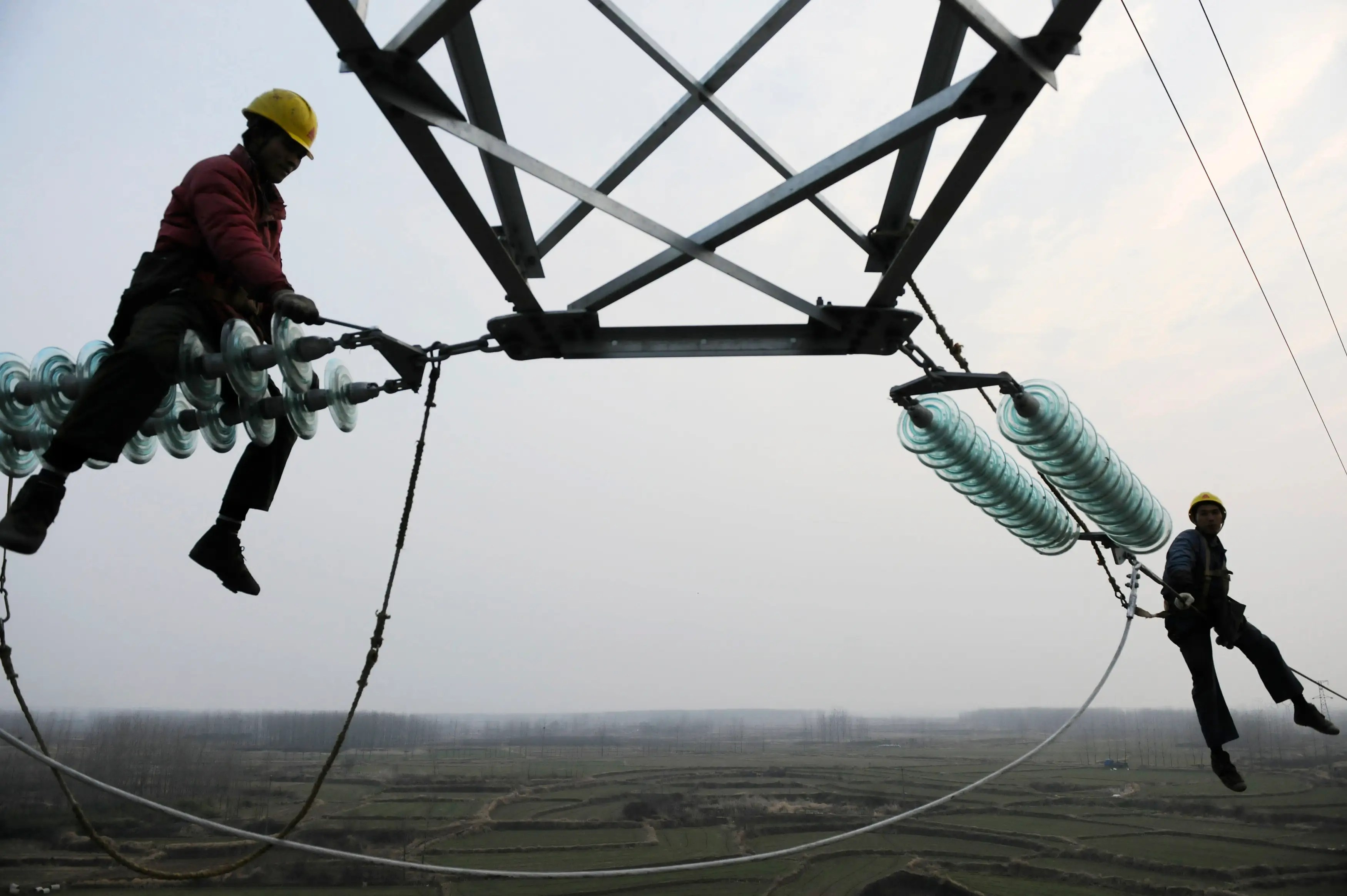 Employees work on a pylon in Chuzhou, in the Anhui province of China.