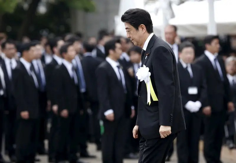 Japan's Prime Minister Shinzo Abe attends a ceremony commemorating the 70th anniversary of the 1945 atomic bombing of the city, at Nagasaki's Peace Park in Nagasaki, western Japan, August 9, 2015. REUTERS/Toru Hanai