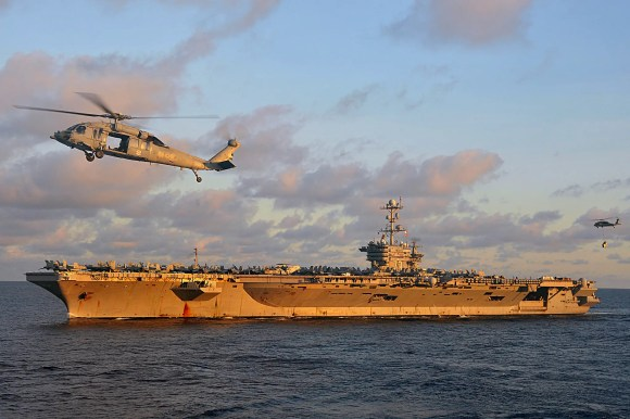 The Nimitz-class aircraft carrier USS George Washington conducts a vertical replenishment at sea in the U.S.