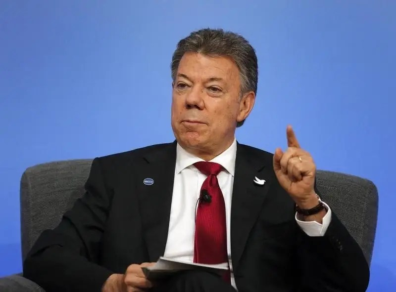 Colombia President Juan Manuel Santos speaks on the podium during a panel discussion at the Anti-Corruption Summit in London, Thursday, May 12, 2016. REUTERS/Frank Augstein/Pool