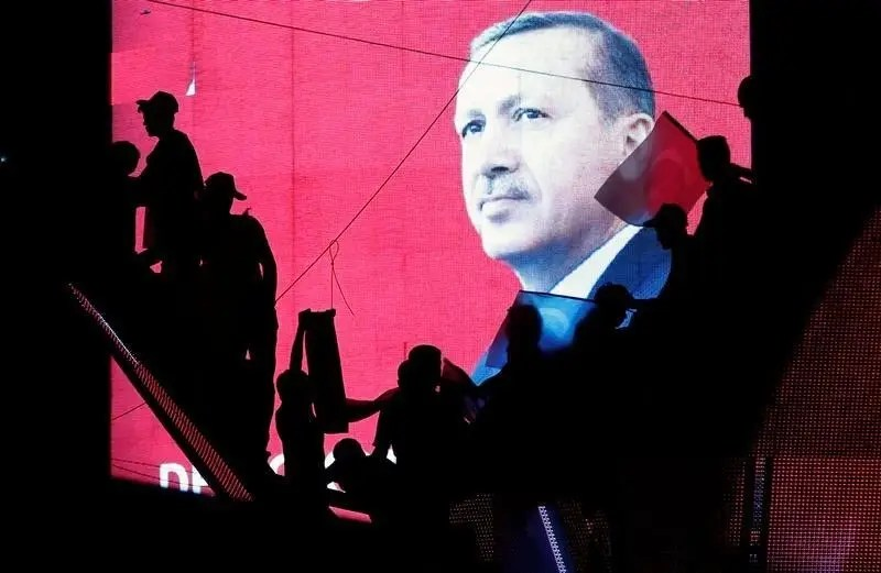Turkish Supporters are silhouetted against a screen showing President Tayyip Erdogan during a pro-government demonstration in Ankara, Turkey, July 17, 2016. REUTERS/Baz Ratner