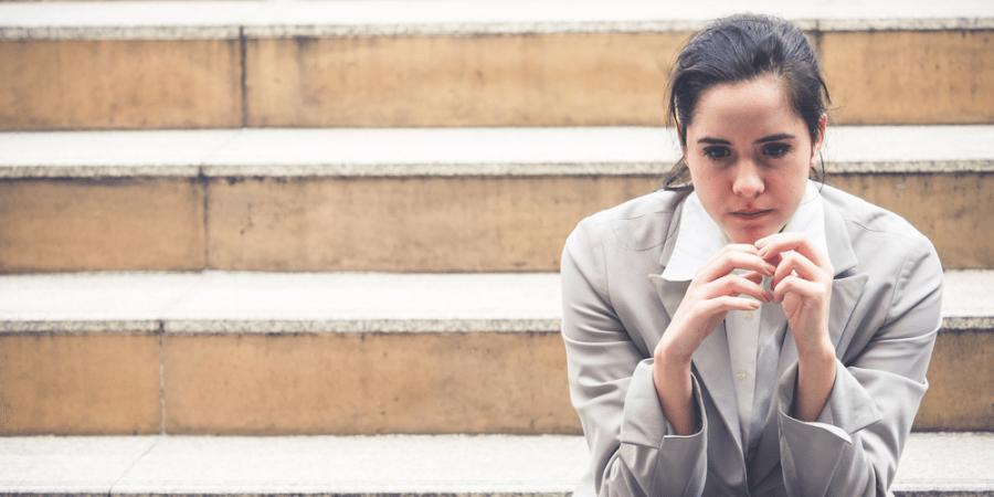 woman upset sitting stairs sad work nervous
