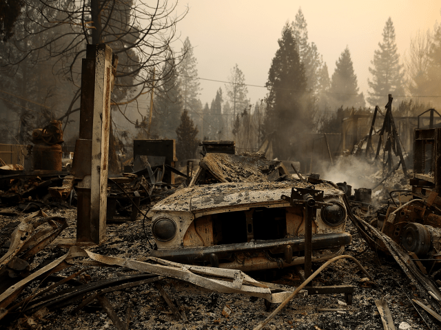 A burned car sits in a burned out business after the Camp Fire moved through the area on November 8, 2018 in Paradise, California.