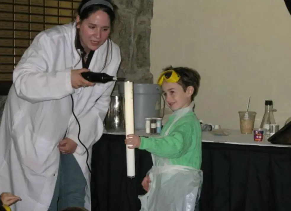 At Mad Science Camp, kids explore chemistry in a lab.