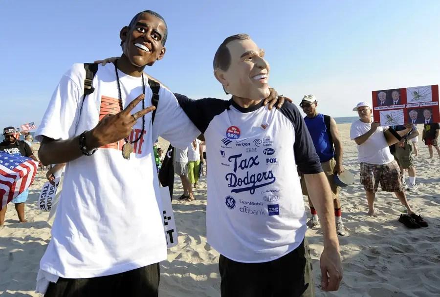 Activists D.J. Friday and John Murdock donned President Obama and Mitt Romney masks respectively.
