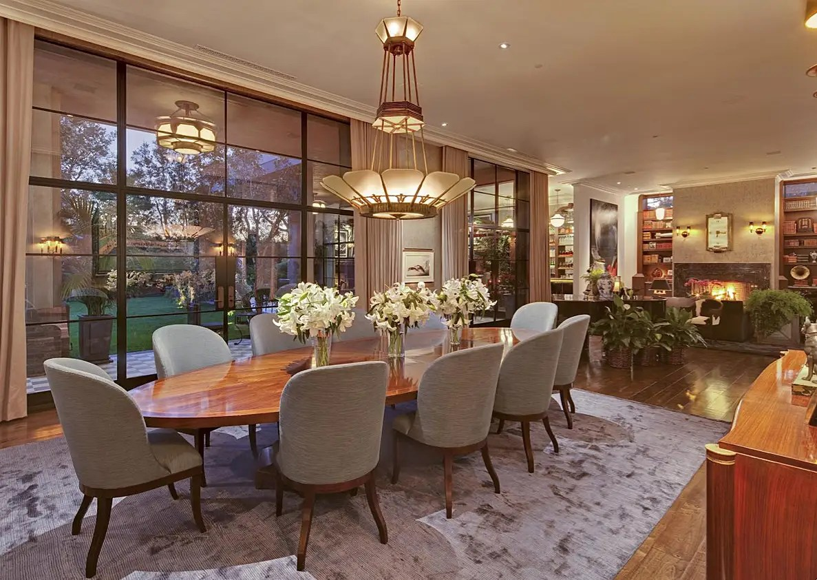 The dining room has ample space for 10, and floor-to-ceiling windows.