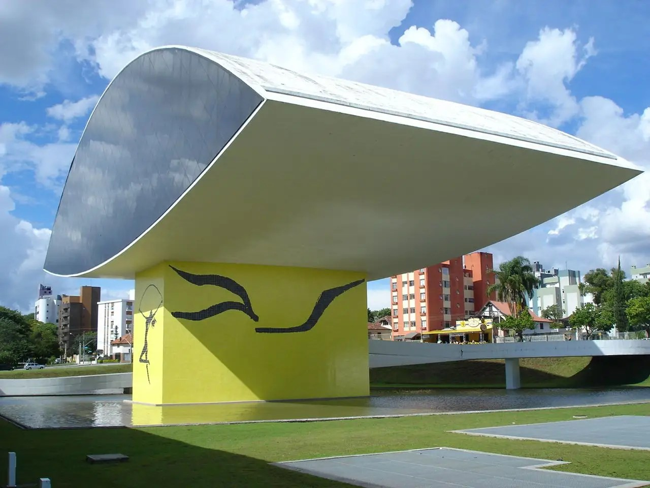 "The Oscar Niemeyer Museum in Curitiba, Brazil is known as the ""Museu do Olho,"" and the ""eye"" can be seen from a distance."