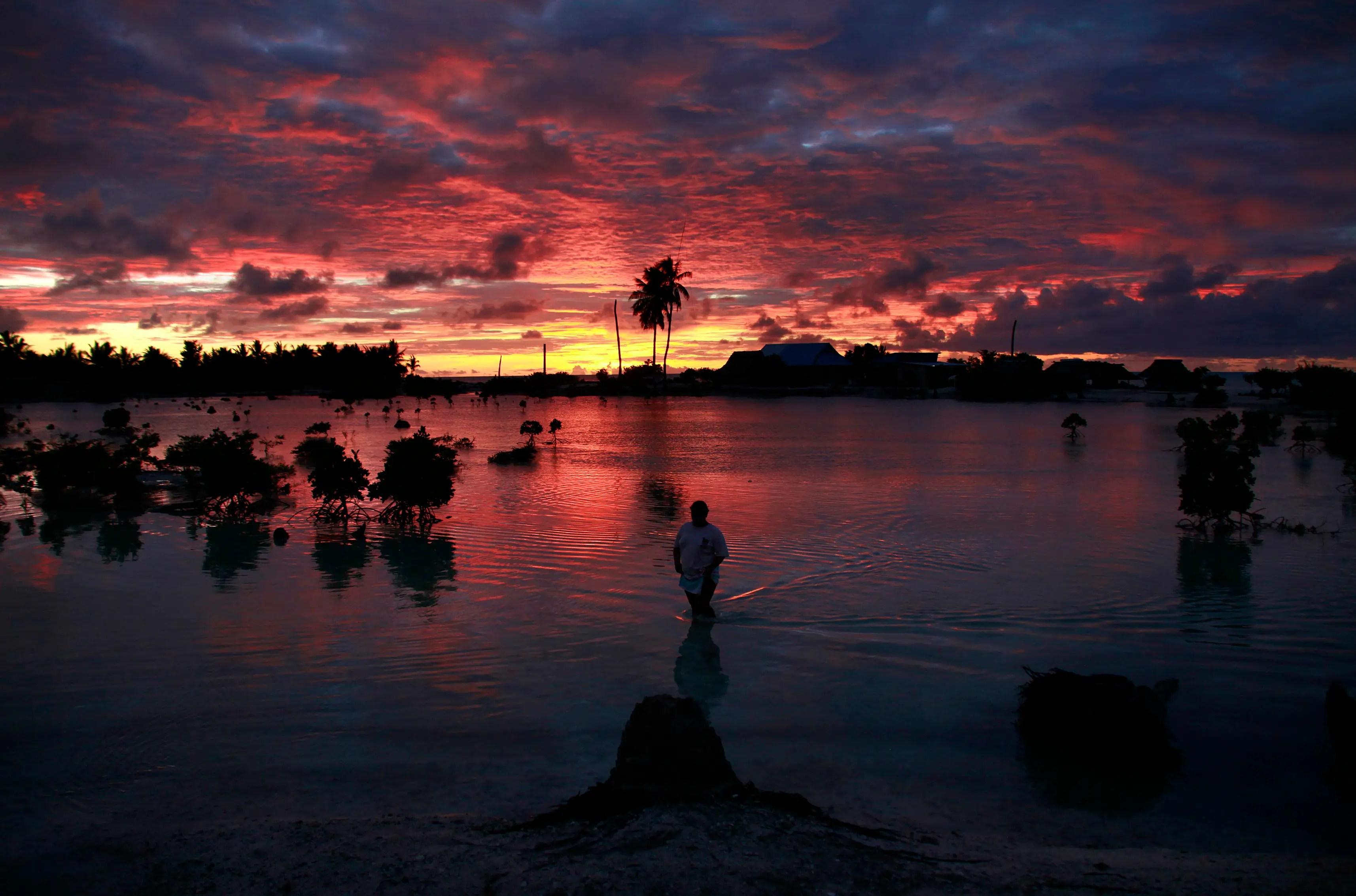 The entire island nation of Kiribati is vanishing because of global warming. On average, land in Kiribati is only six feet above sea level.