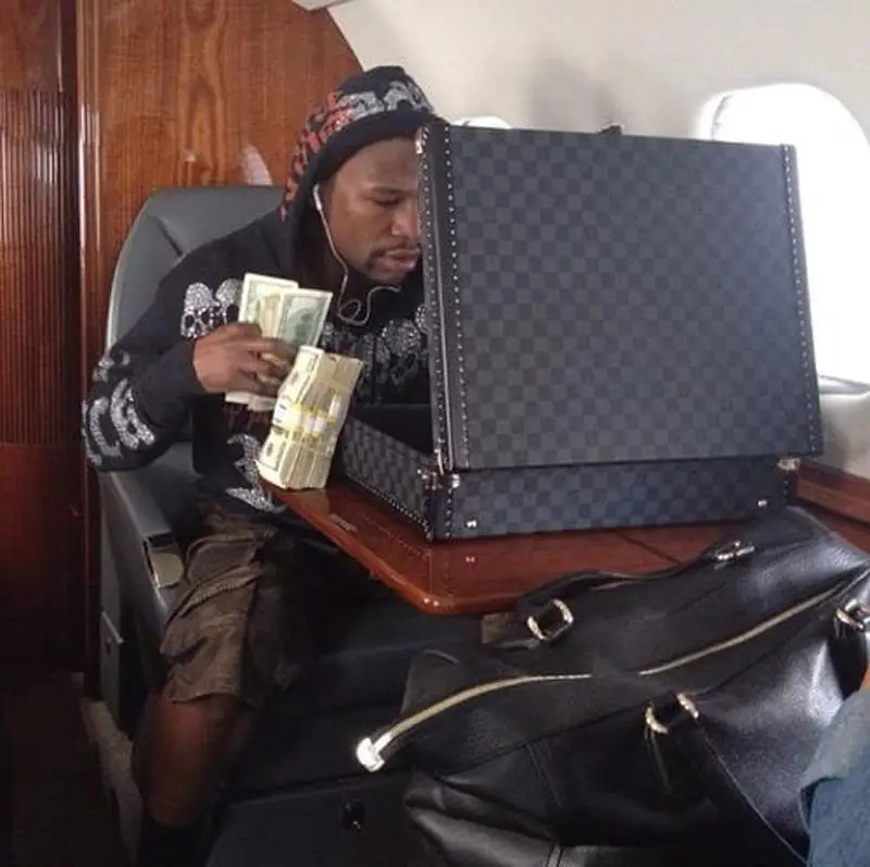 On his private jet with a briefcase full of money.