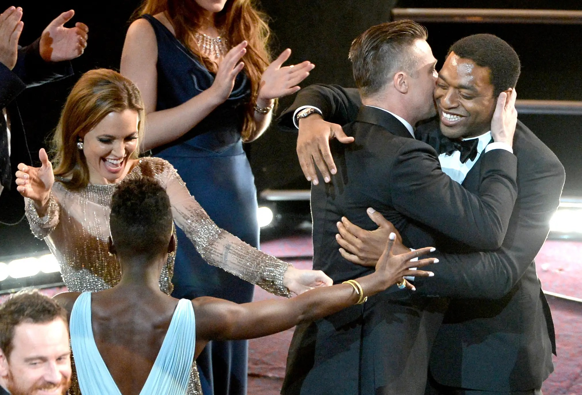 Angelina Jolie and Brad Pitt gave the sweetest embraces to Oscar nominees Nyong'o and Chiwetel Ejiofor.