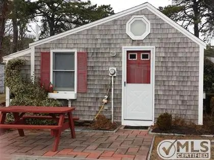 This charming cottage-style is on the Cape.