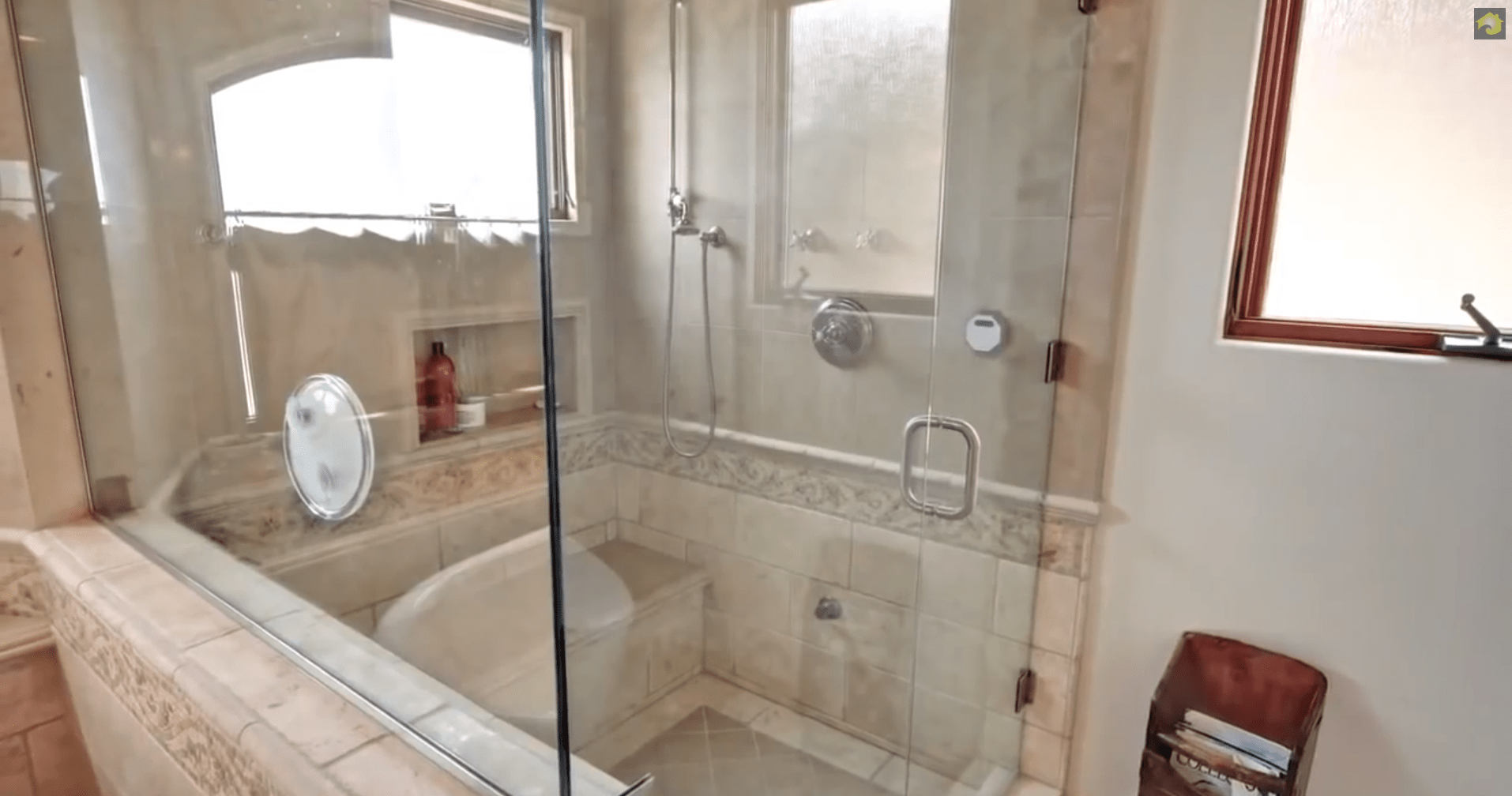 It features a walk-in steam shower.