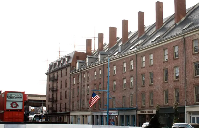 "2013: The buildings were renovated in 1983, but The New York Times said the changes made the block ""into something flat and dull."""