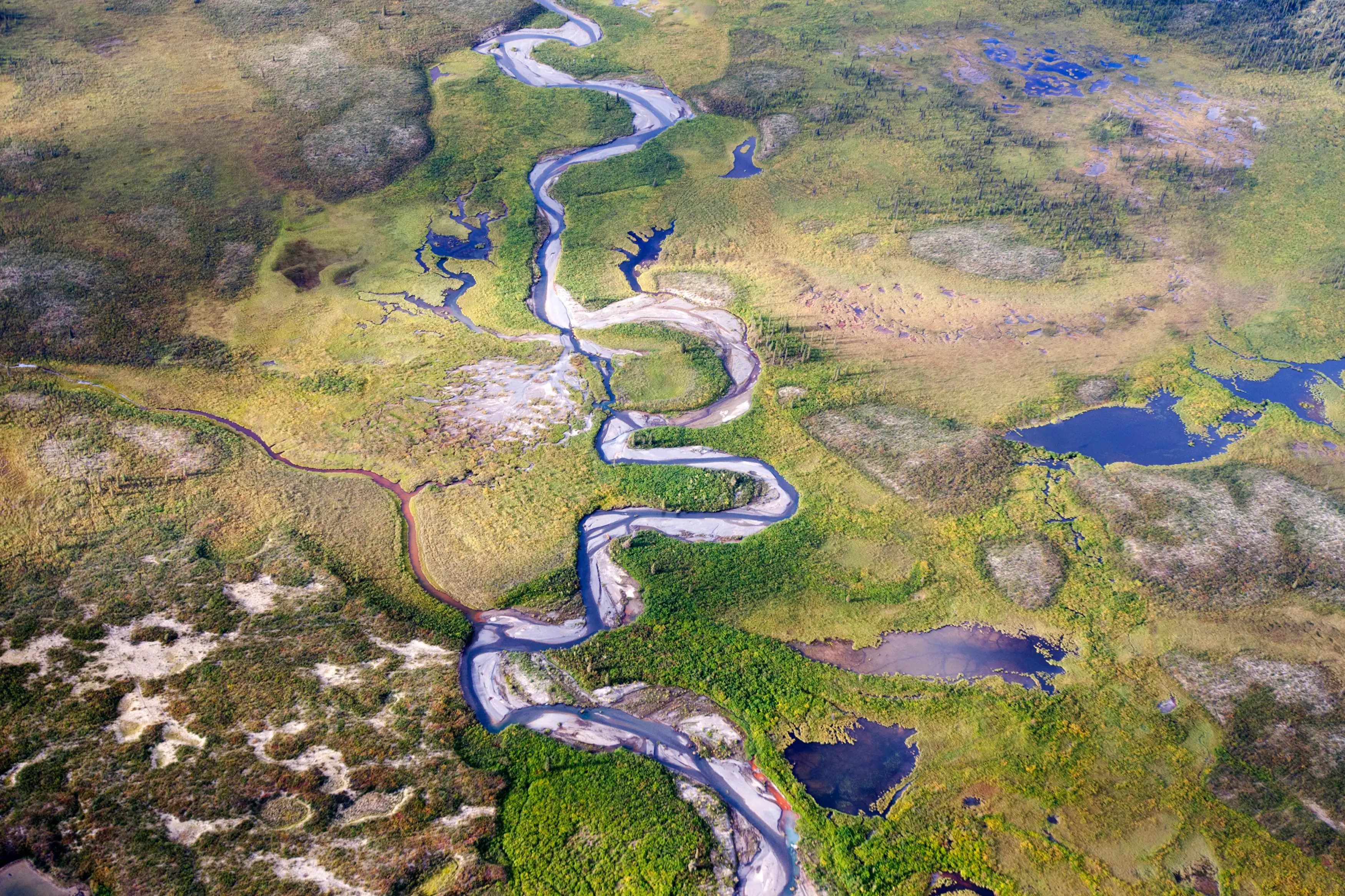 A river runs through a valley near Moose Pond in Canada's Northwest Territories.