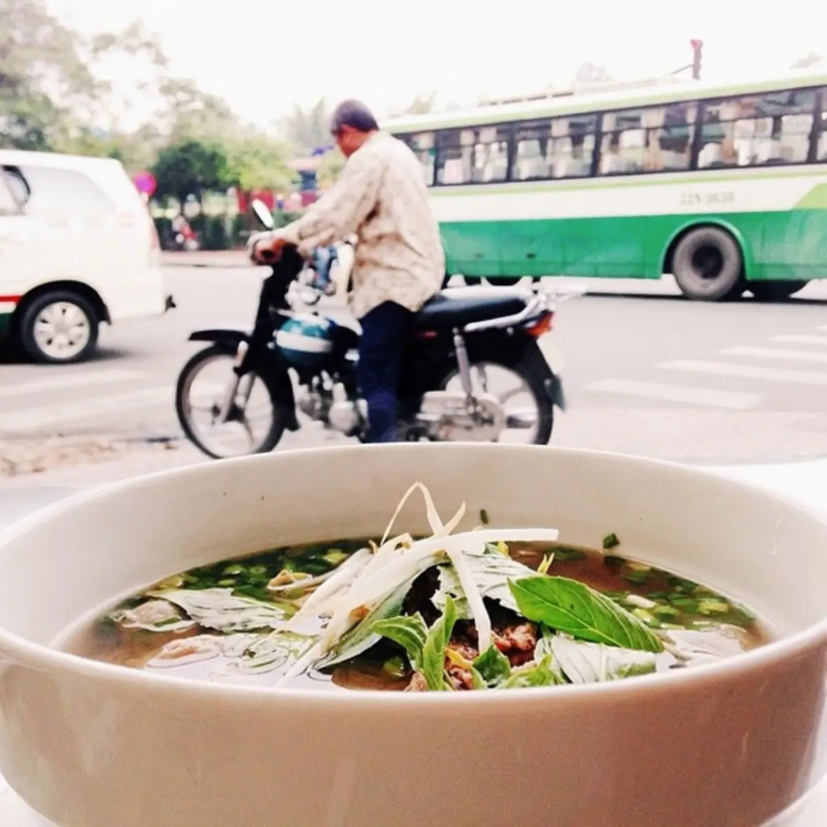 A bowl of pho for breakfast in Ho Chi Minh City, Vietnam. Pho is a Vietnamese noodle soup with the most delicious clear beef broth and plenty of herbs.
