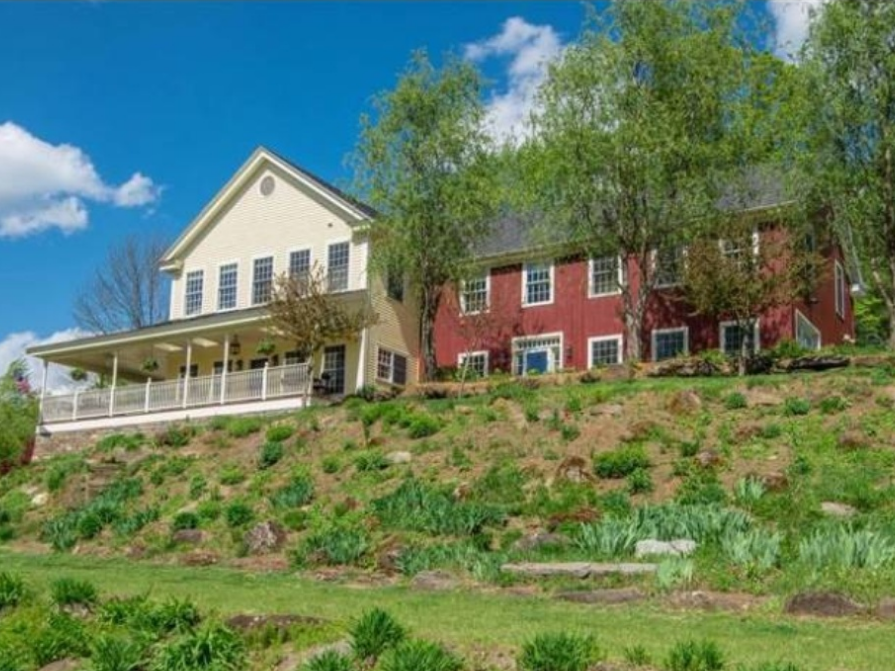 In Woodstock, Vermont, $1.05 million pays for a 4,832-square-foot home with 2 master suites, a wine tasting room, and a detached carriage house.