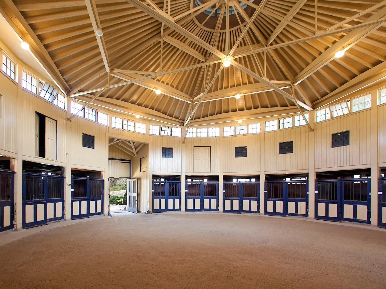 The estate has ample equestrian facilities, including this barn and stable complex. At one time, there were over 30 horses on the property.