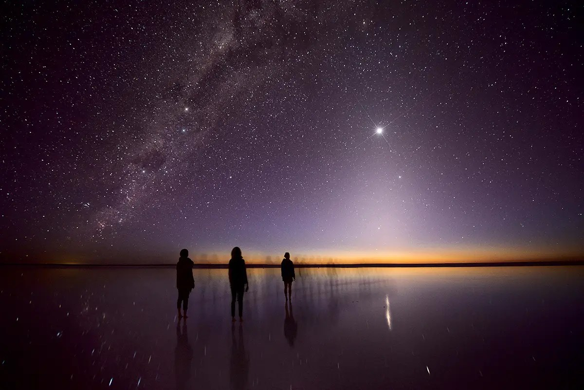 "Julie Fletcher's photo of ""zodiacal light [rising] from the horizon like a pyramid with the brilliant point of Venus at its apex,"" earned her runner up in the ""People & Space"" category."