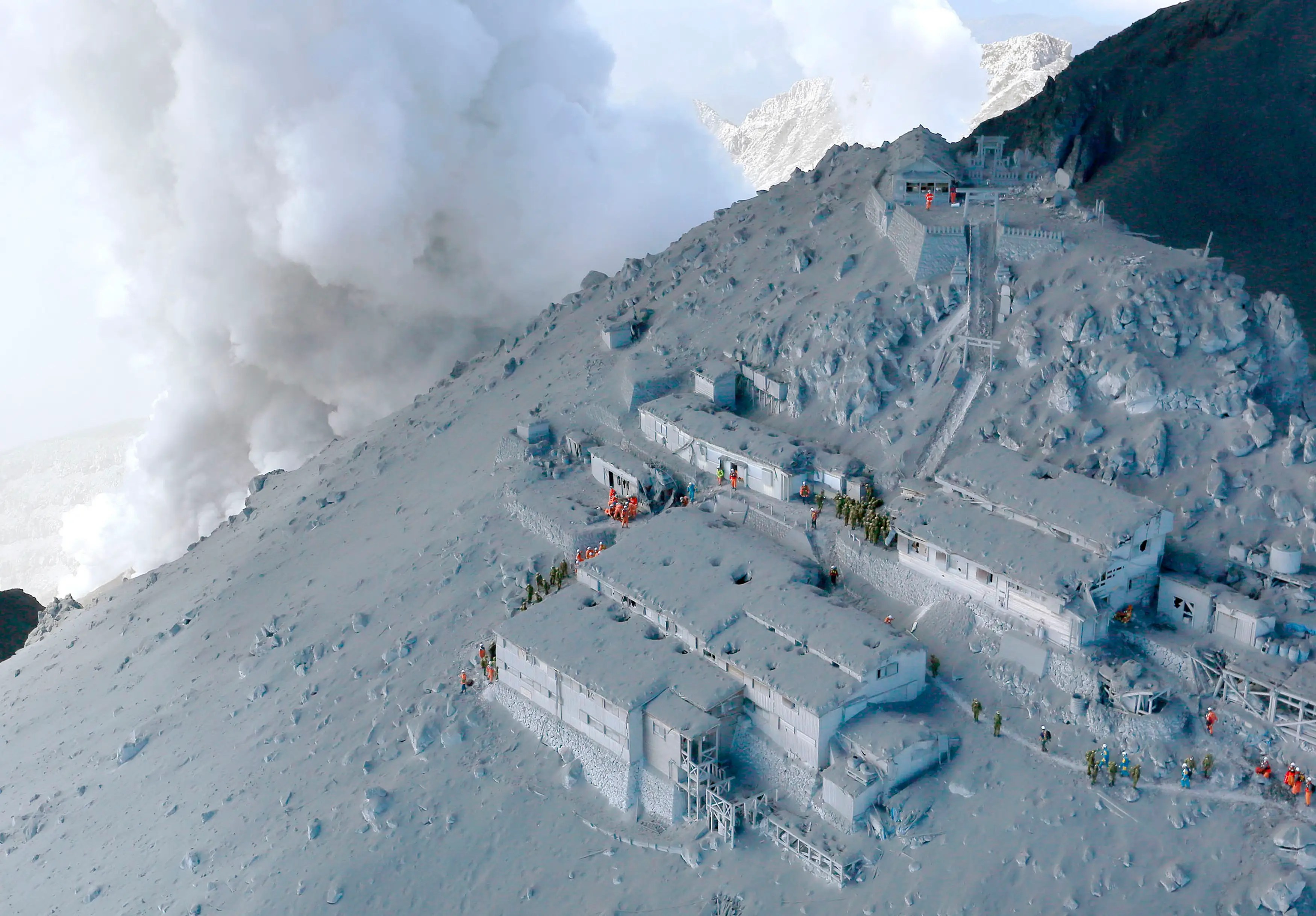 A Japanese volcano erupted without warning in September, covering mountain lodges in a coat of ash.