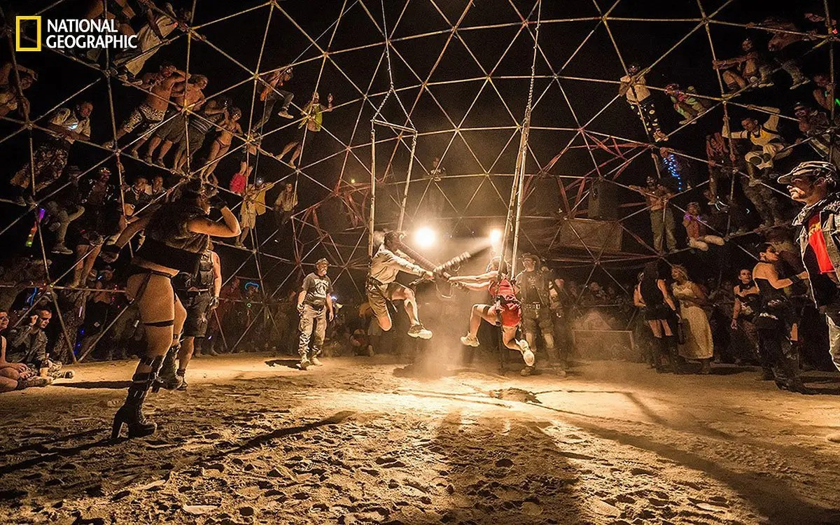 One entry from National Geographic's 2014 Photo Contest shows Burning Man's Thunderdome, run by a group called The Death Guild. In the Thunderdome, combatants use foam bats to assault each other for five minutes while the crowd cheers on from on top the dome.