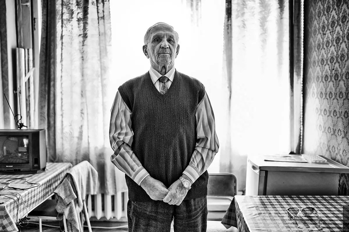 "Nilolay, age 82. Profession: Excavator operator. Passion or Dream: ""I would like to meet a good woman and to get a family."""