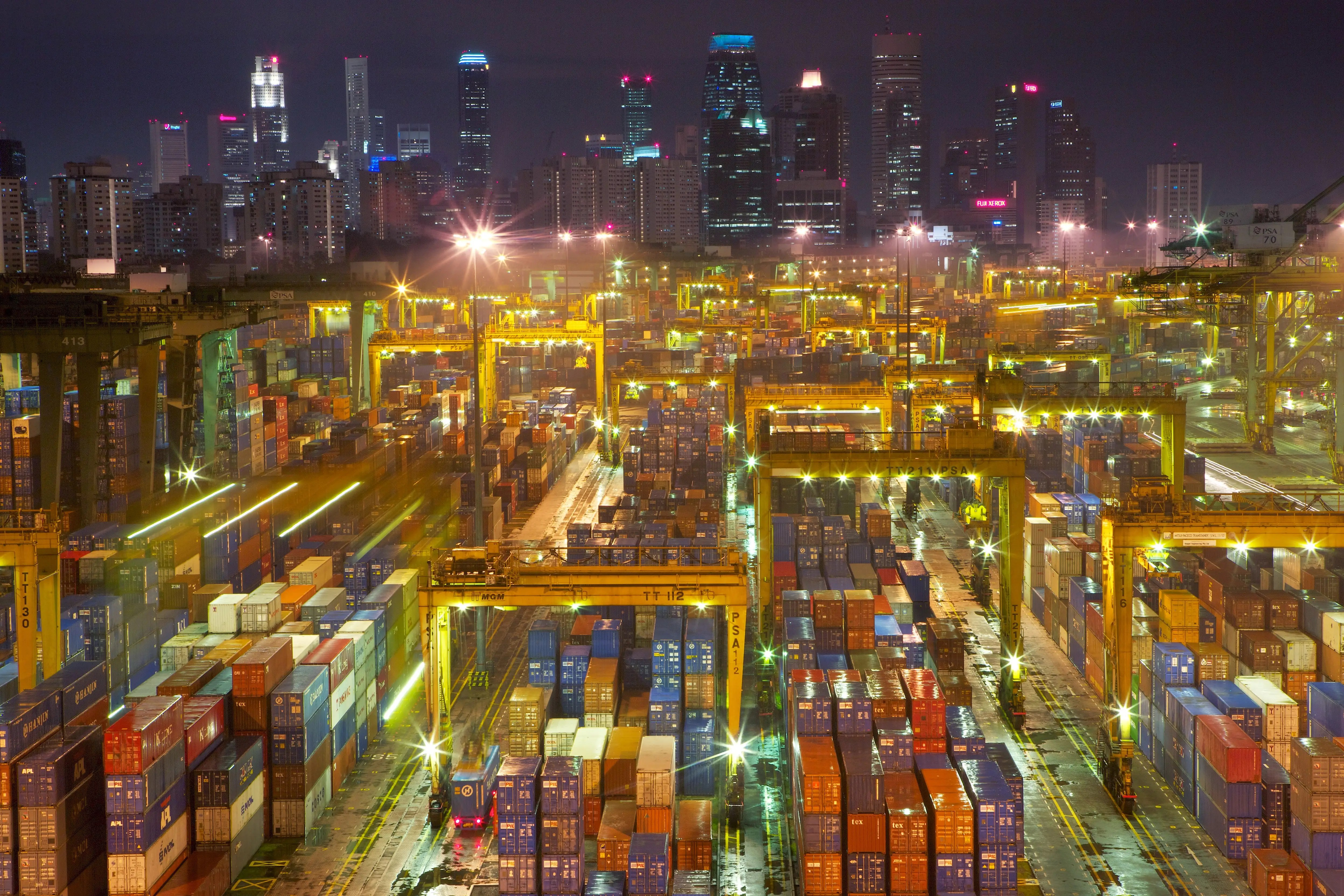 Shipping containers, indispensable tool of the globalized consumer economy, reflect the skyline in Singapore, the busiest transshipment port in the world and the second busiest in total shipping tonnage.