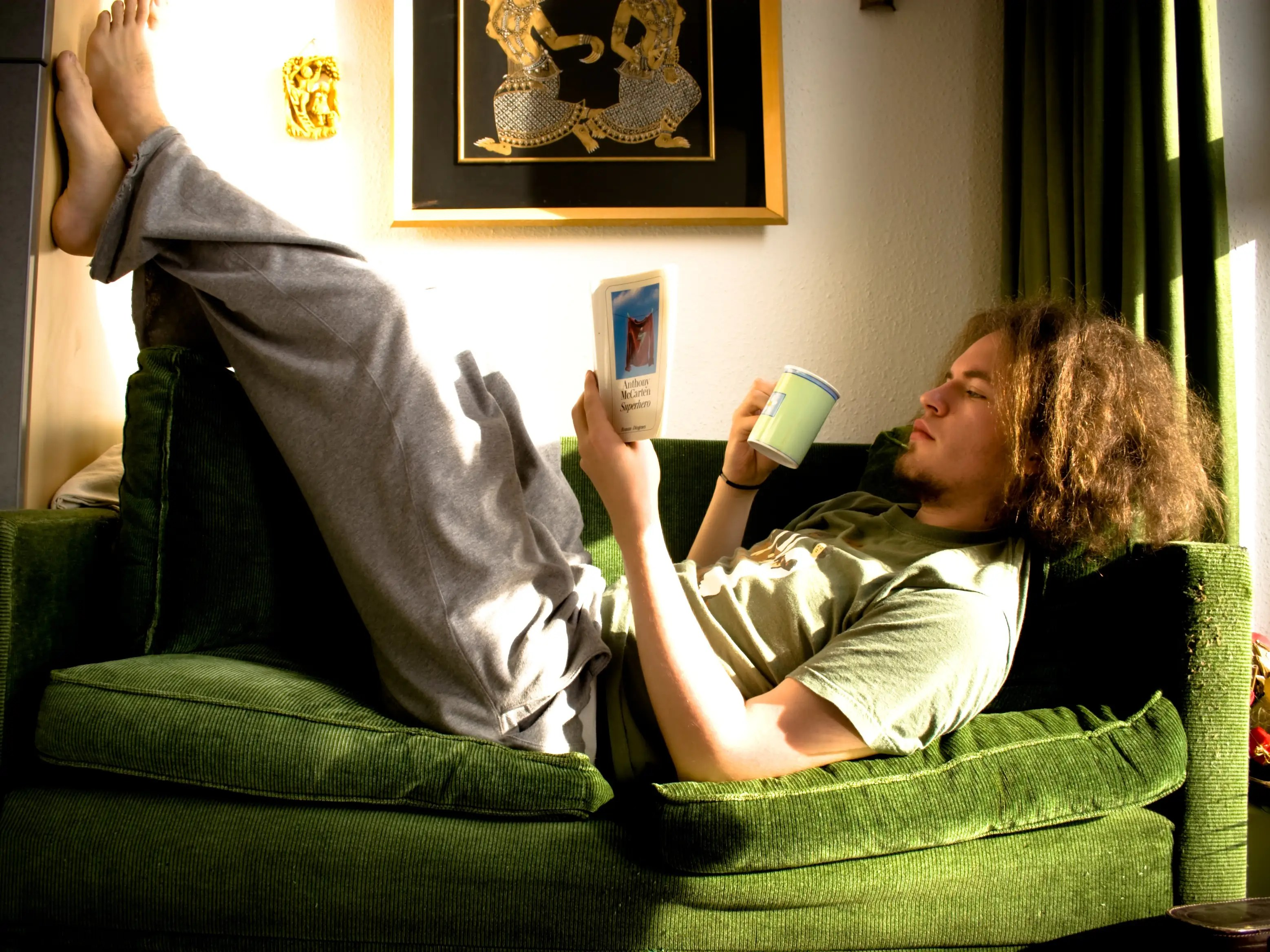 guy reading on a couch books