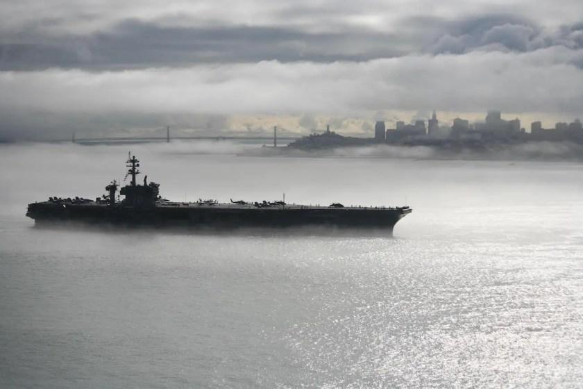 The Nimitz-class aircraft carrier USS Carl Vinson departs San Francisco after participating in San Francisco Fleet Week.