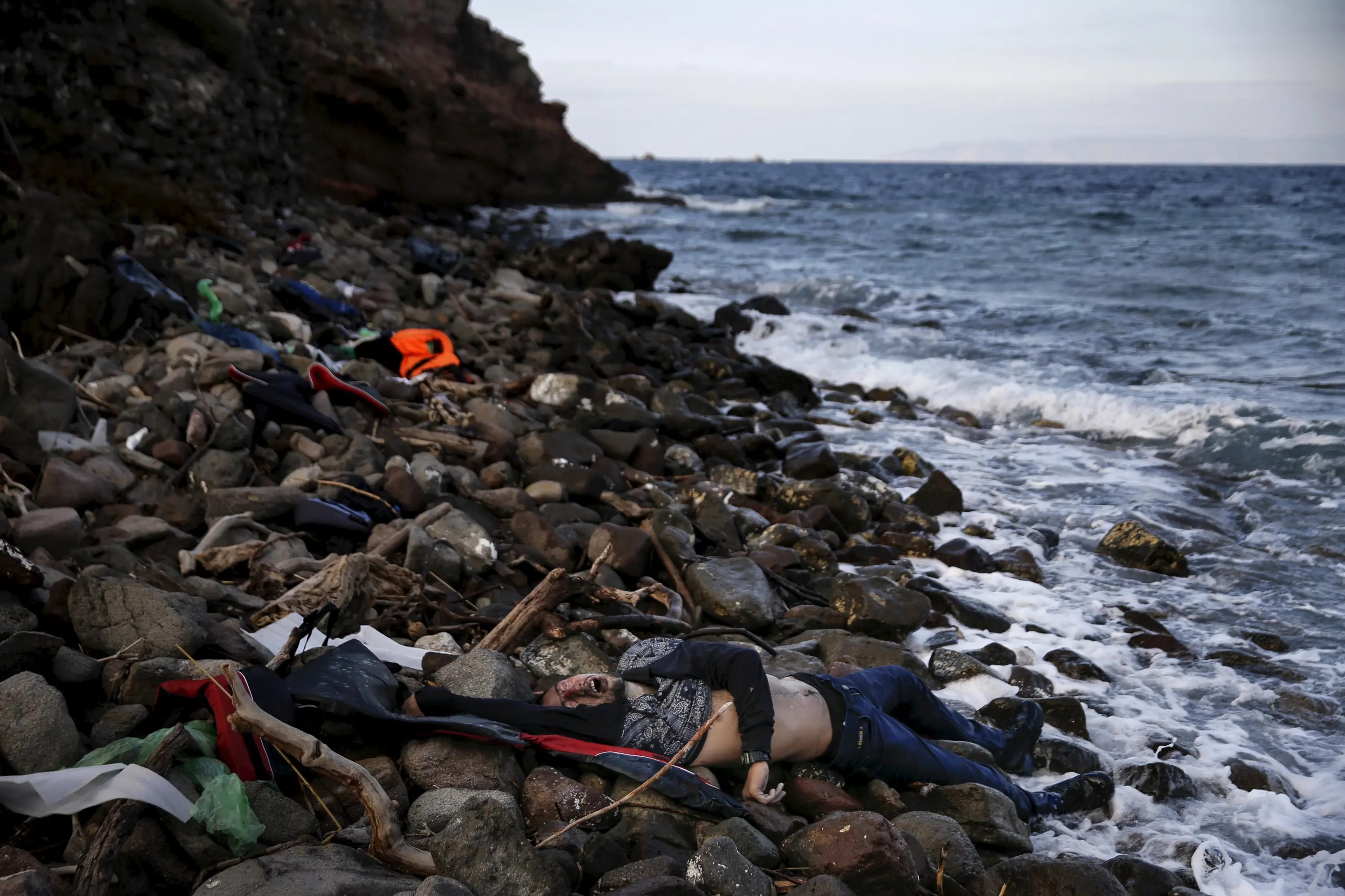The body of an unidentified migrant is seen on a beach after being washed ashore, on the Greek island of Lesbos, November 7, 2015.