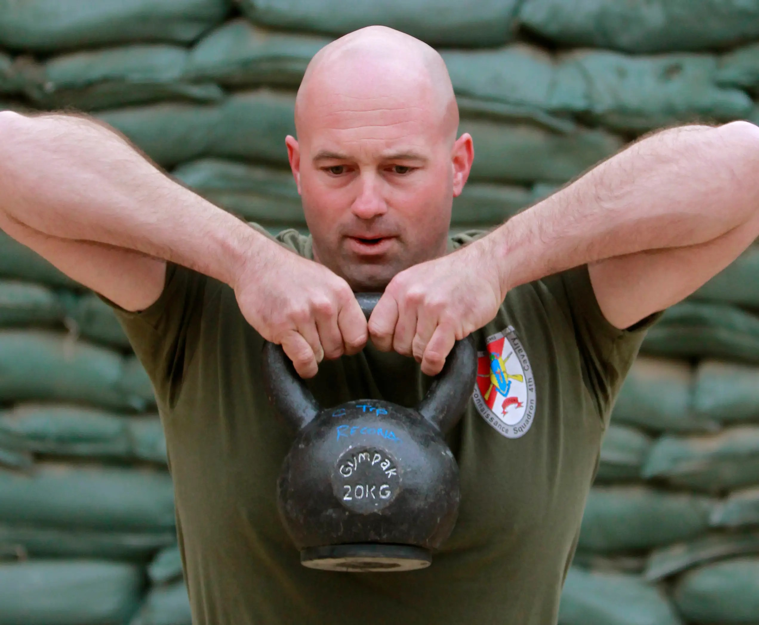 First Sergeant Mac Miller from Comanche Troop, 3rd Squadron, 4th Cavalry, lift weights at Forward Operating Base Connolly in Nangarhar province, eastern Afghanistan, March 3, 2012.