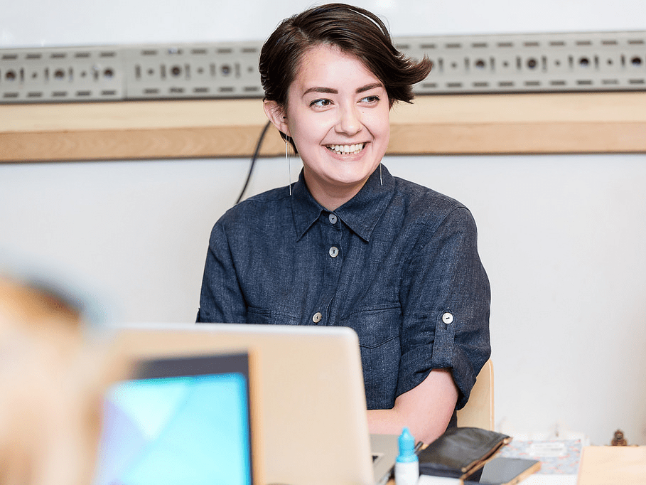 working happy smiling work job laptop