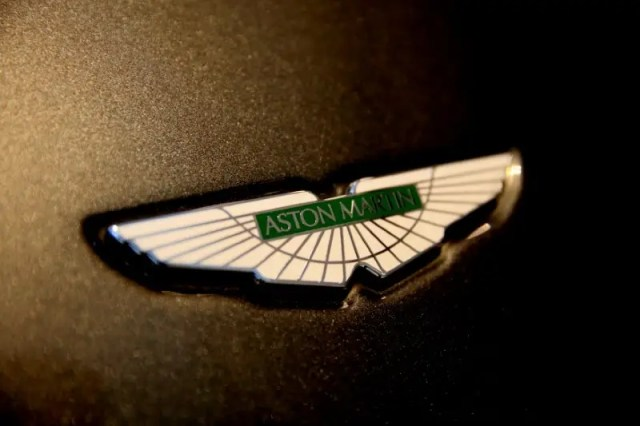 FILE PHOTO: The Aston Martin logo on the front of a car at a dealership in Singapore June 1, 2017. REUTERS/Thomas White/File Photo