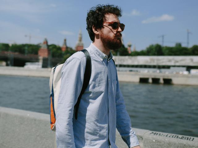 man walking thinking pensive sunglasses
