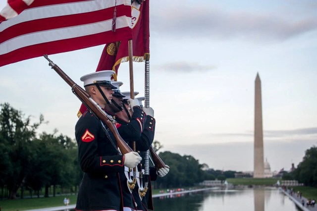 Marines with the U.S. Marine Corps Color Guard marching the National Ensign and the U.S. Marine Corps Battle Colors during a Sunset Parade at the Lincoln Memorial, Washington, D.C.