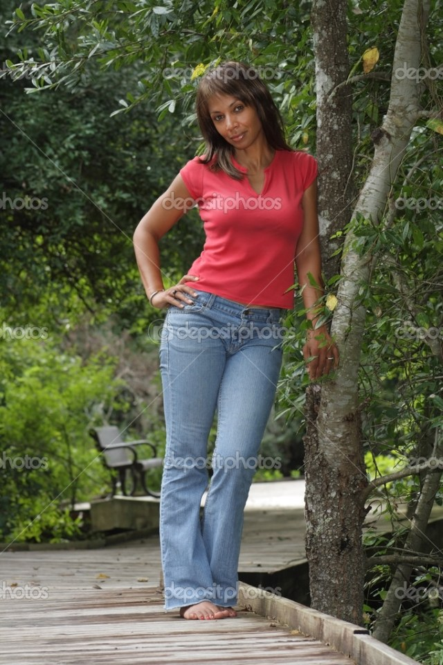 A Lovely Mature Black Woman Stands Leaning Against A Tree On A Scenic Boardwalk Photo By Csproductions
